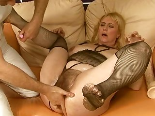 Mature is on the way to the height of pleasure with man's pole fucking her love box