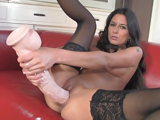Brunette Nikki Daniels groans as she dildo fucks her fuck hole