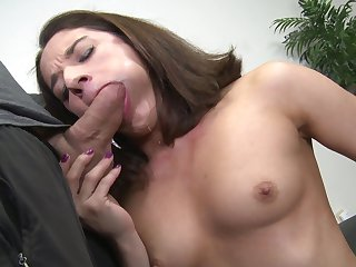 Brunette Sheena Ryder gets down on her knees to gives headjob to handsome guy