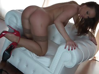 Brunette bombshell Silvia Saint with giant tits has a good time toying her wet spot